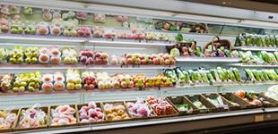 supermarket refrigeration with fully stocked shelves