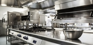 Clean shiny stainless steel commercial kitchen