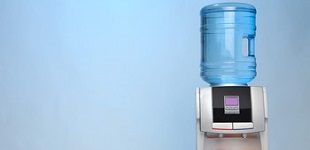 Office water unit in front of blue background